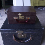 2 leather sm suitcases